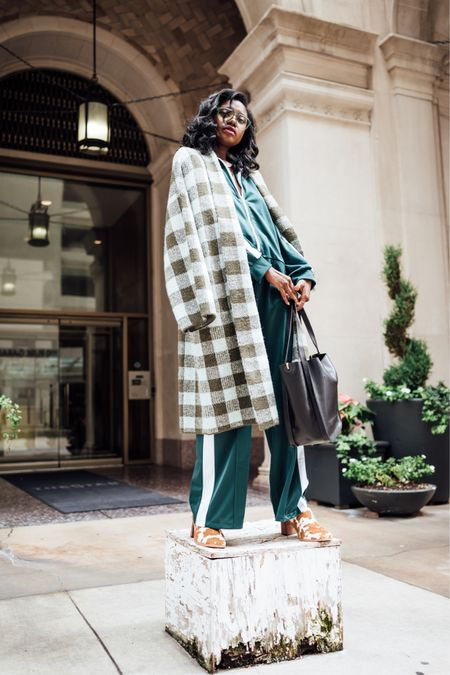 Fall holiday outfit! Long green plaid cardigan, green track pants and green track jacket paired with cow print mules and a black leather tote.   #LTKshoecrush #LTKHoliday #LTKunder100