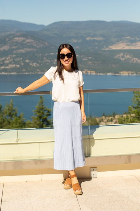 One of my favorite summer outfits: a pleated skirt in a really cool texture (on sale!), a silk tee (so versatile and not see through), and my favorite espadrille wedge sandals - very comfortable and makes me taller 😛.  My sunglasses are under $100 US and I've linked to US and Canadian retailers.   #LTKunder100 #LTKsalealert