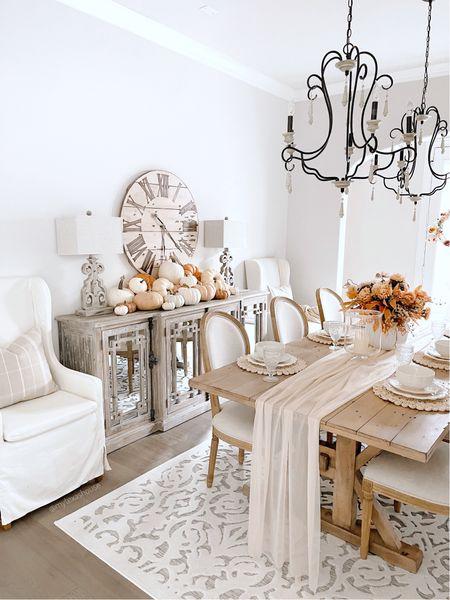 Fall decor, dining room table, buffet, clock, pumpkin decorations, Chandelier, rug my Texas house at Walmart   #LTKSeasonal #LTKhome #LTKunder50