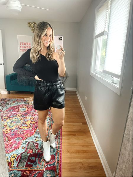 How to style these faux leather shorts! Paired these shorts with the cutest fringe bodysuit and white booties, would be such a cute concert outfit   #LTKunder50 #LTKstyletip #LTKshoecrush