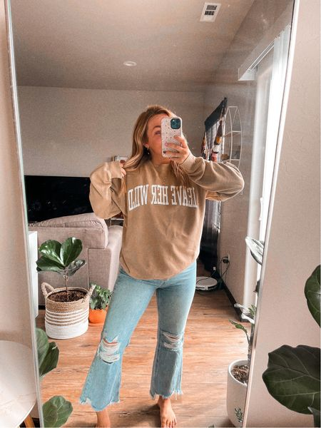 """Oversized sweatshirt customized to say """" leave her wild """"  Shop small Fall outfits Flare crop jeans   #LTKunder50 #LTKstyletip #LTKSeasonal"""