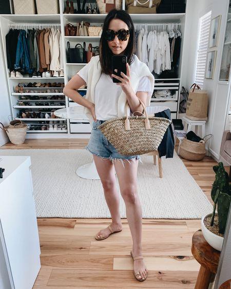 Easy summer outfits. Straw bags.   Tee- Everlane xs Sweater- Everlane xs (linked similar) Shorts- AGOLDE 24 Sandals- Madewell 5 (old) Bag- Mango Sunglasses- Anine Bing (old)  http://liketk.it/3hQP0 @liketoknow.it #liketkit #LTKstyletip #LTKunder100 #LTKshoecrush