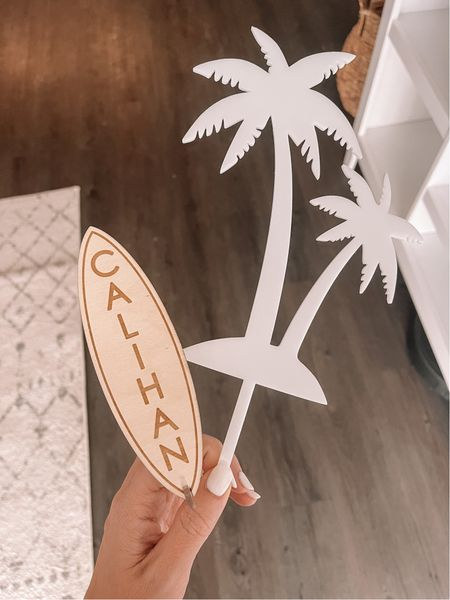 Calihan's cake toppers! Love the surfboard and palm tree cake topper! I also like that you can save the surf board with a separate stand!   #LTKwedding #LTKkids #LTKfamily