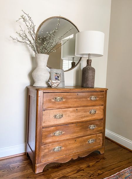 Vintage dresser with a rustic lamp and vase in the entryway.  Entryway decor, home decor, cement lamp, round lamp, dresser  #LTKhome