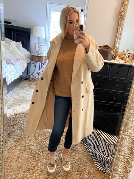 Neutrals… cream Free people calf length coat. Size down  Camel turtle neck sweater, kut from the kloth dark denim skinny jean.  Blowfish patchwork camo and leopard slip on tennis shoes Sherpa lined✔️ . Perfect Fall outfit🍂🍁  #LTKSeasonal #LTKstyletip