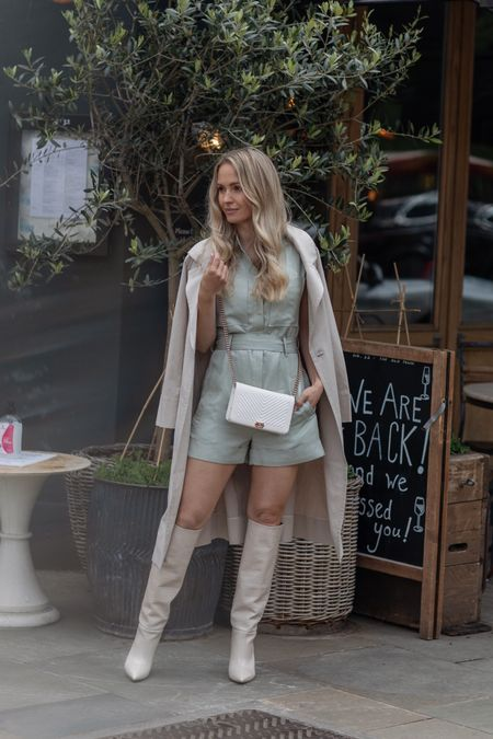 I'm 5'5 and I'm wearing a U.K. 4 in the sage green playsuit. Size down for a better fit.  My beige trench coat is a size U.S 0   My bag is the white chevron caviar Chanel wallet on chain with light gold details   I sized up 1/2 size in my cream Paris texas boots .   #LTKstyletip #LTKSeasonal #LTKDay