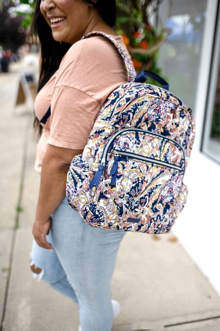 """Vera Bradley new print in tangier paisley + new fall favorites! Use code """"queencarlene"""" for 10% off   Shirt is aerie (L), jeans are seven (31, TTS), & shoes are converse (size down 1.5 sizes)  Vera Bradley collection, travel essentials, #verabradley, travel must-haves, backpacks, floral bags, Vera Bradley travel, casual style, midsize, mid size, aerie, light denim jeans, converse, high rise denim, size 12, size 14, high tops   #LTKcurves #LTKSeasonal #LTKunder100"""