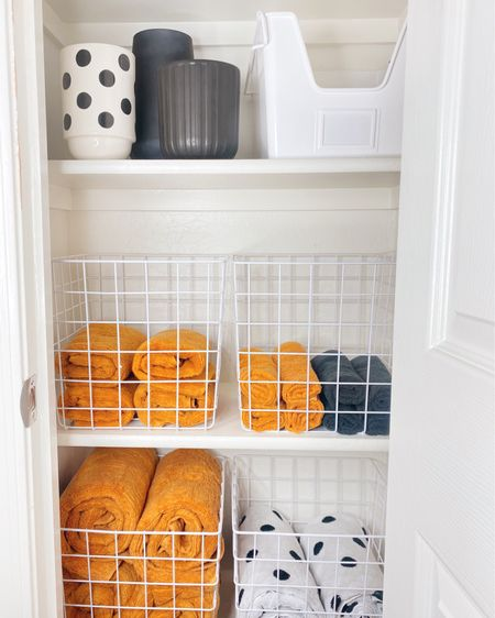 Updated guest bathroom closet 💛 These storage baskets keep things nice and tidy and I'm now hooked on a rolled towel. I also shipped the house to find pretty storage for qtips and cottons balls. See stories for close ups + links.  Everything on my @liketoknow.it page http://liketk.it/3jD8t   #liketkit #LTKhome
