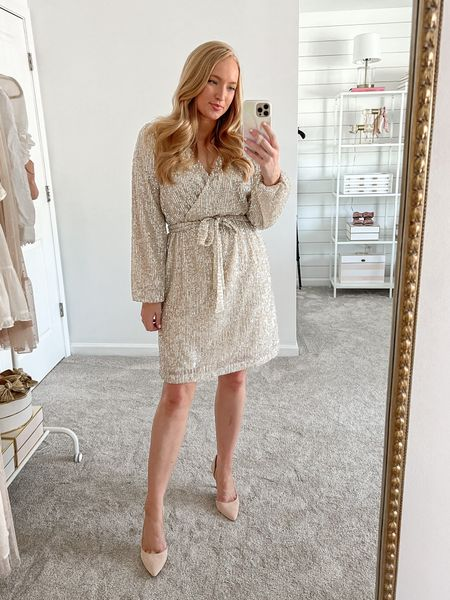 Sequin dress is gorgeous for a holiday party! It's nursing friendly and office appropriate, too. Wearing a size 6 but I need a 4.   #nyedress #newyearseve #sequindress #holidayoutfit #officeparty   #LTKHoliday