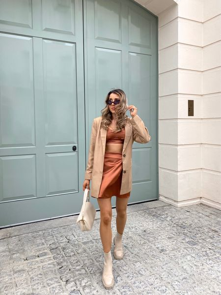 A very autumnal colour palette 🍂 I love the versatility of this Missguided satin wrap over skirt and bralet. You can wear in the day with an oversized blazer to dress this co-ord down or worn with a pair of heels for a night out look.  #LTKeurope #LTKstyletip #LTKunder50