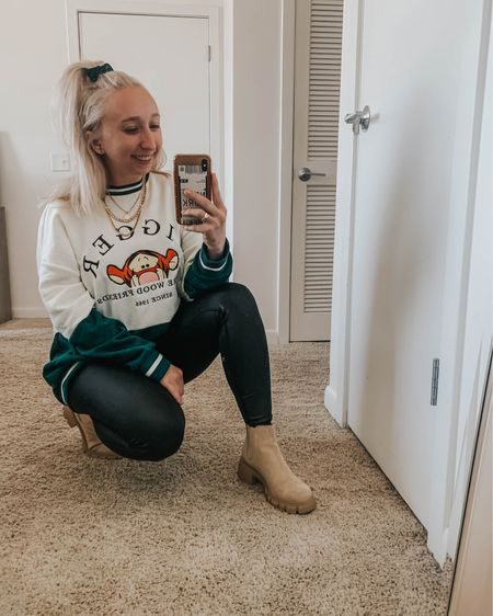 it's called ~disney chic~ look it up ✨  sharing this winter time disney inspired look on the blog today. spoiler alert: it's cute, comfy and affordable 💁🏼♀️  sweater: @boxlunchgifts @disney @pooh  leggings: @marshalls  boots: @stevemadden  jewelry: @adinas.jewels @tiffanyandco @forever21  hair: @dysonhair @forever21   shop the look: http://liketk.it/39xPH #liketkit @liketoknow.it