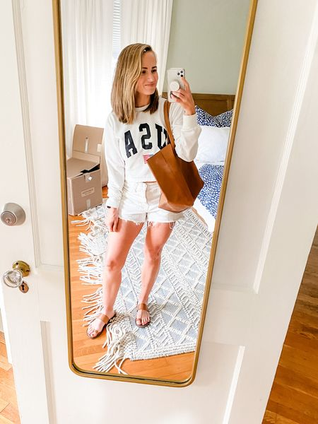 Love my USA sweatshirt, and this leather tote bag! The leather tote bag is huge, and not super structured, so great if you like that style of bag.   #LTKitbag