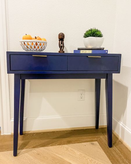 Fall home decor / entry hall decor ideas / navy blue console table with drawers / white basket weave bowl / small green faux plant / little pumpkins    #LTKhome #LTKunder100 #LTKHoliday