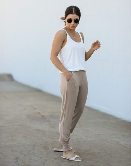 Entire outfit on sale! Ready for the weekend in the comfiest joggers ever and they are on sale! So soft, fit tts. The perfect linen blend tank top to dress up or down. Express outfit travel outfit comfy joggers white tank weekend outfit loungewear    #LTKtravel #LTKstyletip #LTKsalealert
