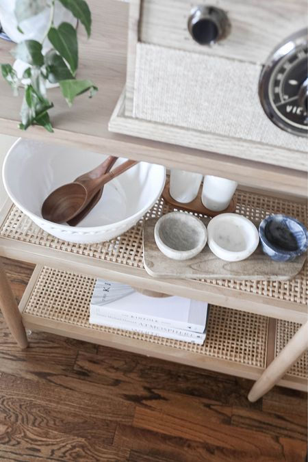 Dining room bookshelf full of serving dishes! Love this pretty natural wood and cane table, and it's so affordable!  turntable, record player, Target home, affordable home decor, Hearth & Hand, Studio McGee, light wood, cane, serving bowls, serving utensils, olive oil and vinegar, coffee table books   #LTKhome