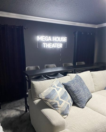 We added these high top tables behind the couch, with these black barstools for extra movie theater seating and a place for people to eat! Both can be found on Amazon or the bar stools can also be found in store at At Home.   The neon sign is from CustomNeon.com but I linked a few Etsy shops that also do Neon signs!   The black velvet curtains were the perfect addition found on Amazon with my all time favorite curtain rod. http://liketk.it/3dPVj #liketkit @liketoknow.it #LTKhome #LTKsalealert #LTKfamily