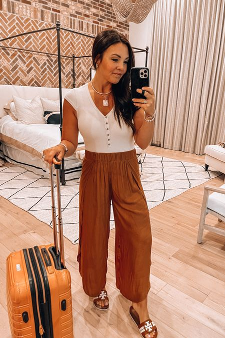 Camel comfy flowy pant- sold out bit linked similar options.   Neutral body suit   Tory Burch camel slides   Ifly suitcase   Gold stack bracelets ans necklaces linked.   http://liketk.it/3jMXD #liketkit @liketoknow.it  Travel outfit  Vacation look Walmart finds  Amazon finds #LTKunder50