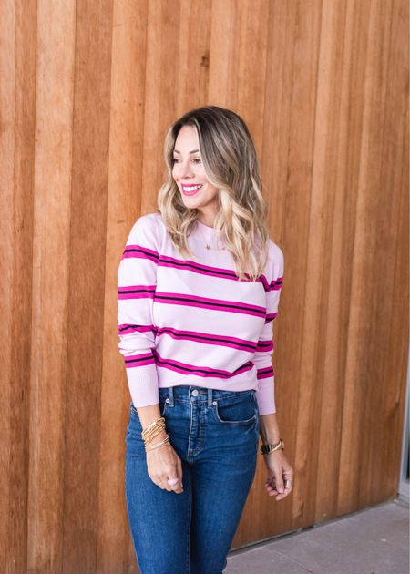 The material of this sweater is super soft with a good amount of stretch, but won't pill. There's solid colors, a fun stripe option, and also one with pearl embellishment that feels smooth on the inside.  The sweaters look great untucked or tucked in.  Sweater Fit: I'm wearing an XXS  Jeans Fit: I'm wearing a 25P  #LTKHoliday #LTKstyletip #LTKSeasonal