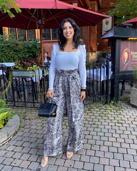 Perfect out for a date night or a night out with your girlfriends! 👯♀️ Linked the original and similar options.  http://liketk.it/2W3wK   #liketkit @liketoknow.it #datenightoutfit #nightout #girlsnight #snakeprintpants #whitetop