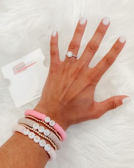 """My custom bracelet stack says """"Be The Light"""" and I am obsessed with this combo!! 🤩 Use code: SARAHJUDE15 for 15% off! Features 2 shades of pink and 1 tan bracelet with 2 gold bead bracelets in between! 15% of all proceeds benefit mental health awareness!! 💛 Screenshot this pic to get shoppable product details with the @liketoknow.it  shopping app: http://liketk.it/3hQcc #liketkit #LTKunder100"""