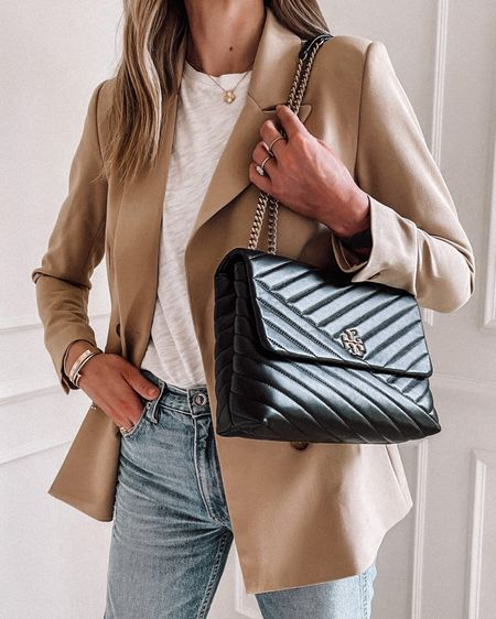 A luxury alternative bag under $1,000! Contemporary designer bags from shopbop! Black bag, Tory Burch, http://liketk.it/3kmT5 #liketkit #LTKstyletip #LTKitbag @liketoknow.it