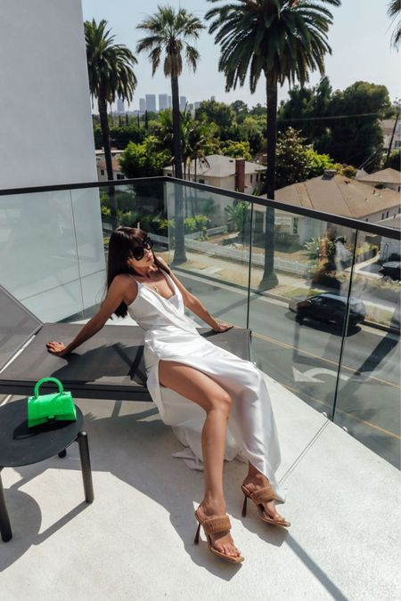 White slip dress with a high slit - perfect summer slip dress! They're super trendy every summer so worth the investment. Paired it with neutral leather sandals and neon green Balenciaga bag for a pop of color   #LTKitbag #LTKshoecrush #LTKstyletip
