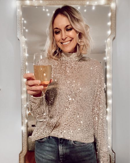 H&M Sequin turtleneck top just $20. Runs TTS, fit is  loose. Linked other sequin tops under $50 as well.  http://liketk.it/2I46O @liketoknow.it #liketkit #LTKholidaystyle #LTKunder50 #LTKstyletip sequins, holiday outfits, New Year's Eve outfits, dressy,