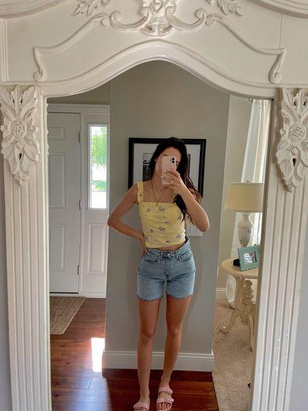 yellow tank top and blue denim midi length high waisted shorts with trendy slide sandals   #LTKSeasonal #LTKstyletip #LTKshoecrush