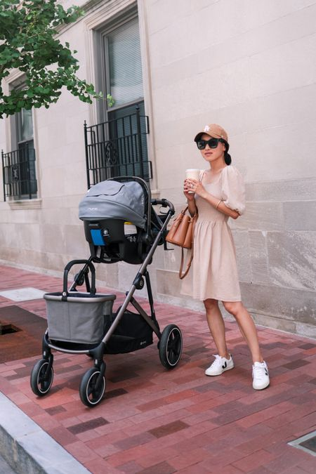 summer dress outfit ideas // teaming up with @Nordstrom to share this bump, nursing and postpartum friendly summer dress + styling it 4 different ways on the blog  •Vero Moda smocked dress xs •Veja Eapalar sneakers size 35 •Quay after hours sunglasses •Cybex Gazelle S double stroller (on sale at Nordstrom!!) •Nuna car seat •Similar bucket bag linked  #Nordstrom   #LTKstyletip #LTKSeasonal #LTKbaby http://liketk.it/3iH0C #liketkit @liketoknow.it