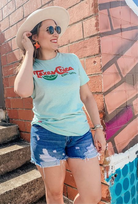 Texas Chica Graphic Tee plus Texas shaped earrings. 😍  #texas #graphictee #tshirt #casual #summerstyle #shorts #hat