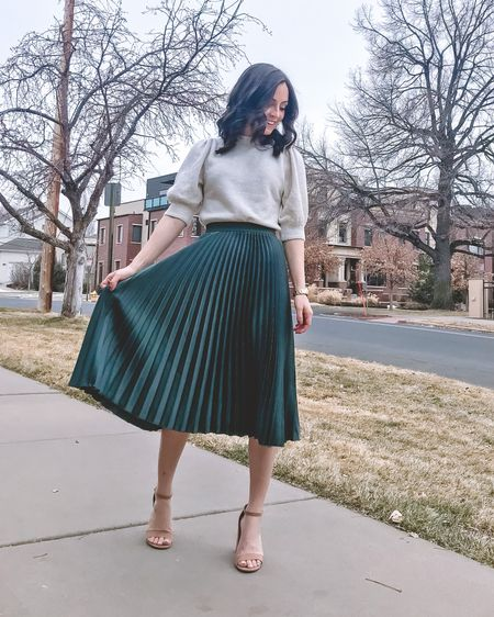 This perfect winter to spring transitional workwear outfit. I just adore this puff sleeve sweater so much...it's the perfect mix of cozy and feminine. This pleated midi skirt is a staple in my wardrobe and comes in so many colors. Pair it with nude heels and you are good to go! Everything runs TTS.  Sweater: S Skirt: XS Heels: 6.5   http://liketk.it/2L2tN #liketkit @liketoknow.it #LTKunder50 #LTKspring #LTKworkwear