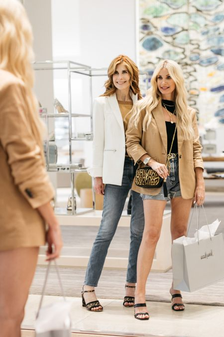 CALLING ALL SHOE LOVERS: Who else loves shoe shopping as much as we do?!  One of my favorite things to do is to go shoe shopping with this beauty and our favorite place to do that is @neimanmarcus!  #ad #neimanmarcus  I've shopping there for years and I can always count on Neiman Marcus to have the most amazing selection of of incredibly chic shoes, both casual and dressy! My latest find are these killer heels by Cult Gaia.  I'm obsessed with the gold chain heel and since the heel height is only 3 inches they're actually very wearable!  To shop my look and to learn more about why we love shopping for shoes at Neiman Marcus click the link in my bio.     #LTKstyletip #LTKunder100 #LTKshoecrush