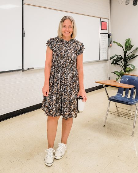 Casual everyday fall teacher outfit featuring a boho floral ruffled tiered dress and comfortable white sneakers #teacher #mom #dress #boho #floralprint #tiereddress #ruffledress #ruffled #tiered #black #sneakers #whitesneakers #Casual #comfortable #Petite #lifestyle #midsize http://liketk.it/3mnkz @liketoknow.it #liketkit