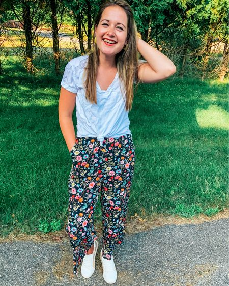 Dress any jumpsuit down by Tying a white tee over it (this one is $8!) and sneaks (also on sale!) Sizing: tee- size up for extra fabric to tie, jumpsuit- tts (or size up for petite), shoes- tts  Sales/deals: tee- $8, jumpsuit 50% off, shoes- $39.99  http://liketk.it/2R8a3 #liketkit @liketoknow.it #LTKstyletip #LTKunder50 #LTKsalealert #whitetee