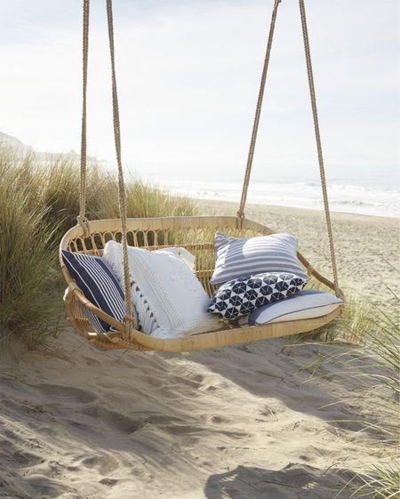 Hanging rattan bench perfect for your front porch   #LTKstyletip #LTKhome #LTKSeasonal