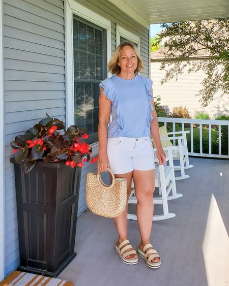 Casual everyday summer teacher mom travel outfit featuring a breezy ruffled ribbed sleeveless tee top, cutoff raw hem white high rise denim shorts, sporty woven platform wedge slide sandals, and a straw bag #teacher #whiteshorts #whitedenim #ruffled #ruffletop #ribbedtop #powderblue #summer #travel #mom #casual #petite #sleeveless #cute http://liketk.it/3hxHe @liketoknow.it #liketkit