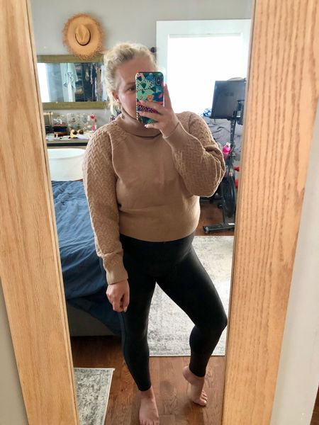 This sweater is super soft and I love the detail on the sleeves. It's cropped so perfect to pair with high waist pants, skirts, or leggings. My faux leather leggings are on sale for a limited time and come in regular, petite, and tall lengths. I'm wearing a medium petite for reference as I'm still nowhere near my pre-pregnancy size.  #LTKsalealert #LTKstyletip #LTKunder100
