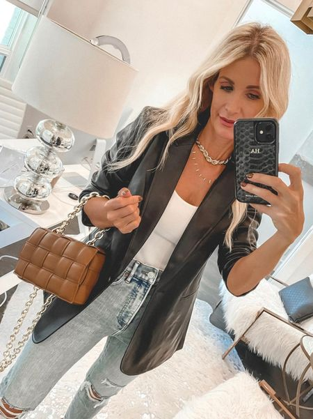 SALE ALERT! My whole outfit is On sale. Obsessed with this black faux leather blazer and you won't believe the price!! My bodysuit, jeans, and heels are too. My blazer  runs tts, I'm wearing an XS. My jeans runs tts I'm wearing a 0. My bodysuit runs tts I'm wearing an Xs.  Follow my shop on the @shop.LTK app to shop this post and get my exclusive app-only content!  #liketkit #LTKitbag #LTKstyletip #LTKunder100 @shop.ltk http://liketk.it/3nuvD  #LTKunder50 #LTKstyletip #LTKsalealert