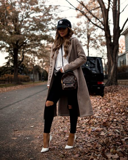 Casual fall outfit  Abercrombie coat LNA white hoodie from revolve Topshop black jeans Louis Vuitton Palm Springs Mini Backpack  White pumps on sale with code FW2021   #LTKSeasonal #LTKstyletip #LTKitbag