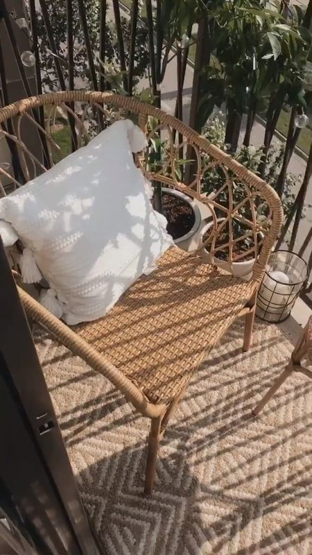 Our neutral, wicker, white and black small balcony set up! Absolutely love this tiny and cozy patio space.  Could not be more in love with these perfect outdoor club chairs and side table. The quality is amazing and the design is so perfect. Incredibly comfortable too! Bonus: they are on sale!  White lantern is from Ikea, black lantern is from Home Depot, and the rug is Home Depot. Similar outdoor throw pillows linked (black and white throw pillows is exact!) but check out your local Home Goods too, they have great options!  🤍🤍🤍  Outdoor decor. Outdoor furniture. Patio furniture. Balcony set up. Balcony decor. How to style a balcony. How to style a patio. Adorable outdoor furniture and decor.   #LTKhome #LTKsalealert #LTKSeasonal