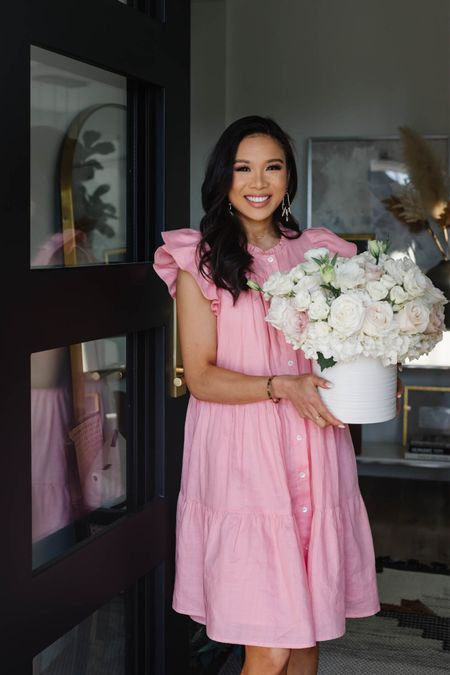 Pink ruffle dress for summer perfect for bridal showers, baby showers and date night. Also linking my Charlotte Tilbury makeup favorites on sale, including her foundation and lip liner. My entryway has this wool runner rug that is so easy to care for and I love the colors.   #LTKhome #LTKbeauty #LTKsalealert
