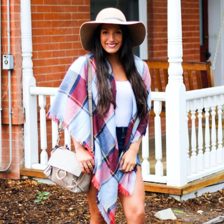 That feeling when you just want it to be fall but it's 95 degrees out.😂 What are y'all shopping for right now?🍂 Summer items or fall items?🤔 This scarf is back in stock and $45.🙌🏽 It also comes in a gorgeous red and orange plaid combination.✨Personally, I can't wait for fall and some cooler temps!😅  You can instantly shop my looks by following me on the LIKEtoKNOW.it app   http://liketk.it/2DYis @liketoknow.it #liketkit #LTKunder50 #LTKtravel #LTKstyletip #LTKsalealert