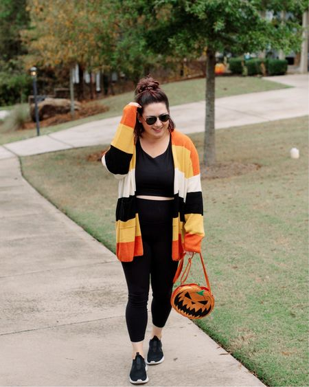 two more days of spooky season. 🎃  Leggings + a longline sports bra + a cardigan is clearly my WFH uniform these days. Linked my sports bra + leggings, sweater & bag are Unique Vintage!   #LTKcurves #LTKFall #StayHomeWithLTK