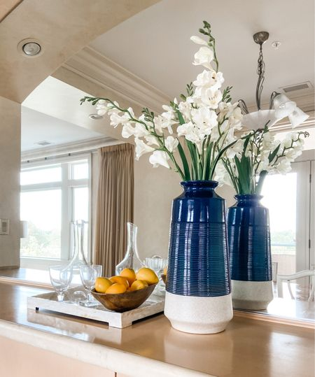Bar vignette with a large blue vase and flowers.  Home decor, dining room decor, bar decor, gray, navy vase, faux flowers, faux fruit  #LTKhome