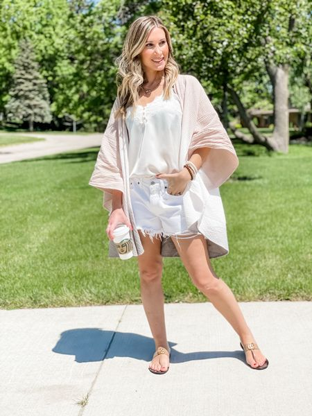 My gauze wrap kimono from Target is perfect for laying in the summer or use as a swimsuit cover up. My lace camisole and distressed boyfriend shorts are from Abercrombie. Size up one in the shorts. My sandals are currently 20% off.    http://liketk.it/3gtOz #LTKsalealert #LTKstyletip #LTKunder100 #liketkit @liketoknow.it #LTKDAY