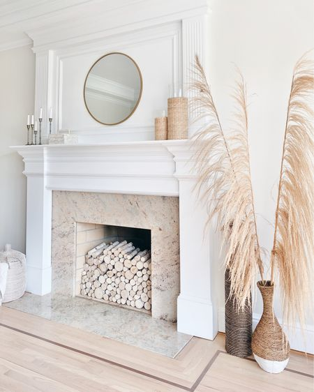This is our dining room - currently in use as a homeschool classroom.  My husband really has a field day with this fried grass decor 😁😁.   If you have an unused fireplace this is a fun way to dress it up.  I can't remember if I used 3 or 4 bundles of wood.  Linking home decor! @liketoknow.it #liketkit http://liketk.it/2TjU1 #LTKsalealert #LTKhome #LTKunder50