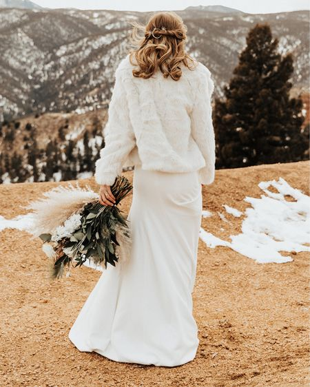 This bride to be rocked a stunning faux fur white coat from Abercrombie! While it's no longer available, check out some similar options we've linked here! #liketkit http://liketk.it/3eFuU  @liketoknow.it