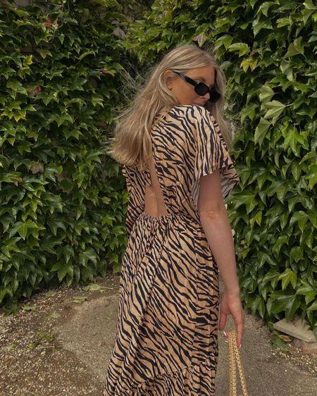 Animal print dress, midi dress, summer dress, backless dress , black sunglasses @liketoknow.it #liketkit http://liketk.it/3khYl #LTKeurope #LTKunder50 #LTKstyletip