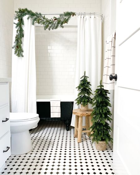 Who says your bathroom can't be festive? Just add a garland and some faux winter pine trees and bring those Christmas vibes into your self-care routine! http://liketk.it/34tDa #liketkit @liketoknow.it
