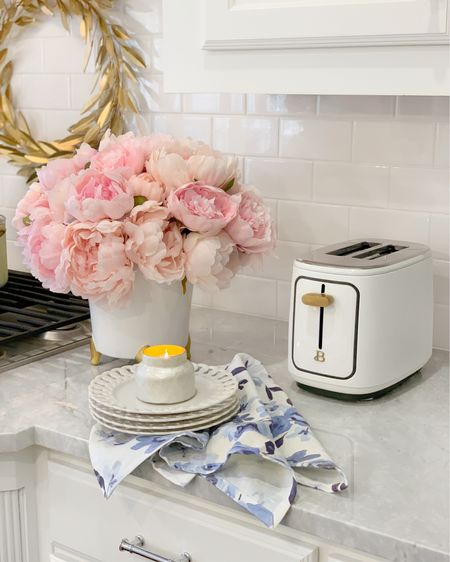 White and gold toaster under $40, blue and white kitchen towel, pierced plates, pink peonies, kitchen decor summer decor @liketoknow.it #liketkit http://liketk.it/3hXZ2 #LTKhome #LTKsalealert #LTKunder50